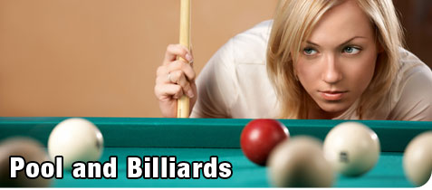 Young, Attractive, Blonde Woman Lining up her Shot During a Game of Billiards